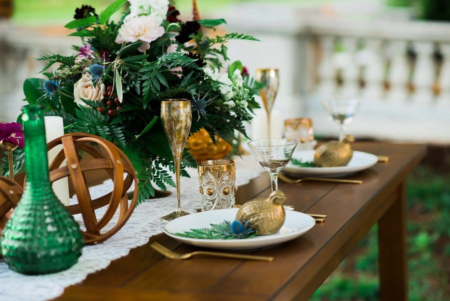 Sweetheart table with elegant dinnerware in a styled placement at Swannanoa Palace. Photo by Maddie Williams Photography.