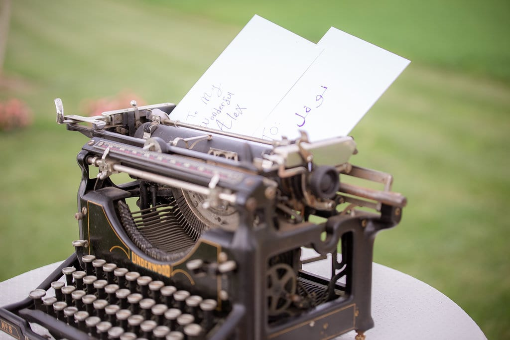 Final details of wedding preparations. Vintage typewriter with wedding notes and letters.