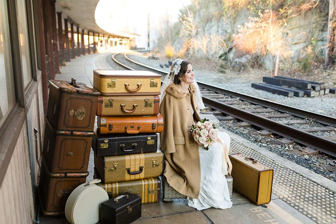 A bride waits for a train by Stelle Rose at Staunton Station. Photo by Christy McKee Photography